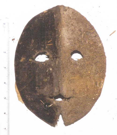 A vizard mask dating to sometime between the sixteenth and the eighteenth centuries. Aristocratic women wore these in public, partly to conceal their identities, and also partly to protect themselves from the sun. This mask is made of black velvet (which is badly discolored now) and silk. The user would keep it on by holding the black bead in her mouth.